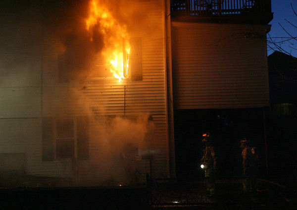 Gloucester: Gloucester firefighters stand by last night as a fire at 13 Commonwealth Ave. is knocked down from the inside. Everyone in the building got out safely. Photo by Kate Glass/Gloucester Daily Times