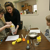 Essex: Laurie Lufkin helps Lily Schrafft measure flour as Nicholas Bartlett looks on while making blueberry muffins during a Cooking Wizards class at the Essex Senior Center on Wednesday. The class, which is sponsored by the Essex Youth Commission, runs through April 14th. Photo by Kate Glass/Gloucester Daily Times