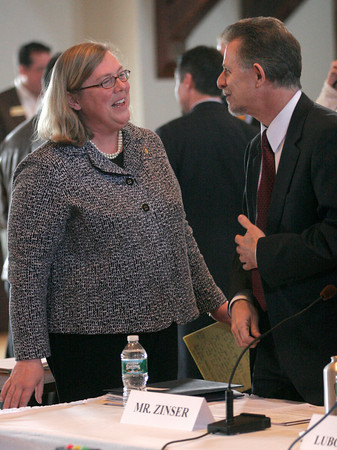 Gloucester: Gloucester Mayor Carolyn Kirk speaks with Todd Zinser, Federal Inspector General,as he appears at Gloucester City Hall to testify at a hearing of the U.S. House Oversight and Government Reform Domestic Policy Subcommitee yesterday focusing on fisheries enforcement practices. Photo by Kate Glass/Gloucester Daily Times