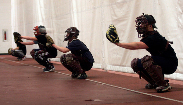 Gloucester: Brett Cahill warms up with the catchers during the first day of baseball practice yesterday. Photo by Kate Glass/Gloucester Daily Times