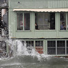 Rockport: Customers at the Bean & Leaf Cafe on Bearskin Neck appear unfazed as waves spash up against the building shortly after high tide yesterday. Photo by Kate Glass/Gloucester Daily Times