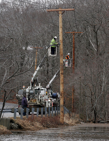 Rockport: Verizon crews repair phone lines along Thatcher Road near Farm Lane yesterday. The lines had been knocked down by trees that fell during Thursday's storm. Photo by Kate Glass/Gloucester Daily Times