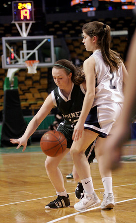 Boston: Manchester Essex's Jessica Crossen tries to dribble past Cohasset's Rachel Fredey in the MIAA Division 4 State Finals at the TDGarden in Boston yesterday. Photo by Kate Glass/Gloucester Daily Times