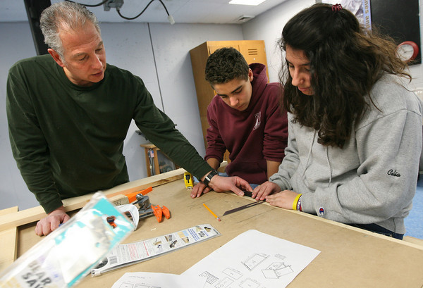 Gloucester: Stephen Sacca, an MIT alumnus of East Gloucester, helps Zachary Dasilva and Celia Sanfilippo, both eighth grade students at O'Maley Middle School, measure an angle using a bevel as they make an Eastern Bluebird Nestbox yesterday. The program is sponsored by the Gloucester Education Foundation's Sea Initiative, a collaboration between the Gloucester Public Schools and MIT. Photo by Kate Glass/Gloucester Daily Times