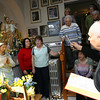 Gloucester: Father Ronald Gariboldi blesses Frances Ferrante's altar to Saint Joseph as she stands with her daughter, Rep. Ann-Margaret Ferrante, and guests gathered for the occasion. Ferrante will host the Feast of Saint Joseph tomorrow night and has had between 30 and 40 people gathered for novenas every night since March 10th. Photo by Kate Glass/Gloucester Daily Times