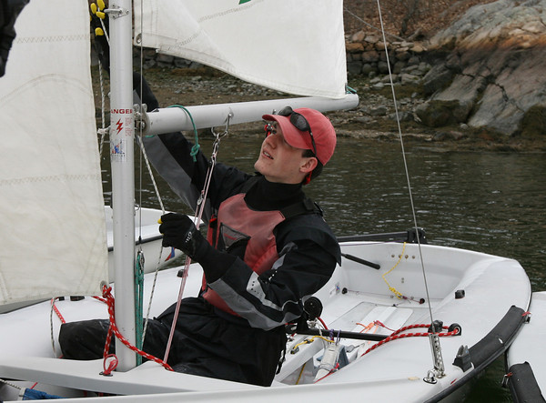 Manchester Essex sailor Sam Cushing adjusts tension on his sail as he prepares for their race against B.C. High. Photo by Kate Glass/Gloucester Daily Times