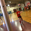 Rockport: Eva Weinstein, a sophomore at Rockport High School, tries to get the volleyball over the net as the sophomore girls play the junior girls as part of Spirit Week yesterday. Photo by Kate Glass/Gloucester Daily Times