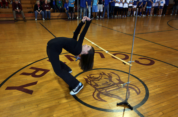 AMY SWEENEY/Gloucester Daily Times. Anna Bittenburg, a freshman, came in second in the limbo during Rockport High School's spirit week assembly.