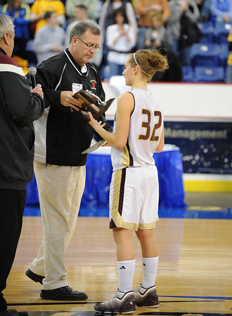 Lowell: Hannah Cain receives a plaque after loosing in the division 2 North Finals to Arlington Catholic at the Tsongas Arena Saturday night in Lowell. Desi Smith/Gloucester Daily Times.