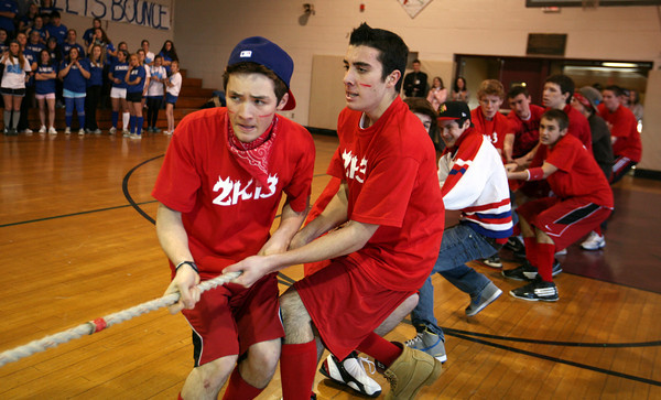 Dylan Chaney, left, and Colby Foster, sophomores at Rockport High School, lead the tug-of-war for their class during Spirit Week's final assembly. AMY SWEENEY/Gloucester Daily Times.