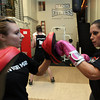 Gloucester: Merry Swan, left, and Briana Spohr participate in a cardio kickboxing class at Aldo's Fitness yesterday. Photo by Kate Glass/Gloucester Daily Times