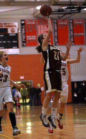 Gloucester guard Katie Ciaramitaro drives toward the net during their 66-62 win over Reading in the MIAA Division 2 North Semi-Finals at Woburn High School last night. Photo by Kate Glass/Gloucester Daily Times