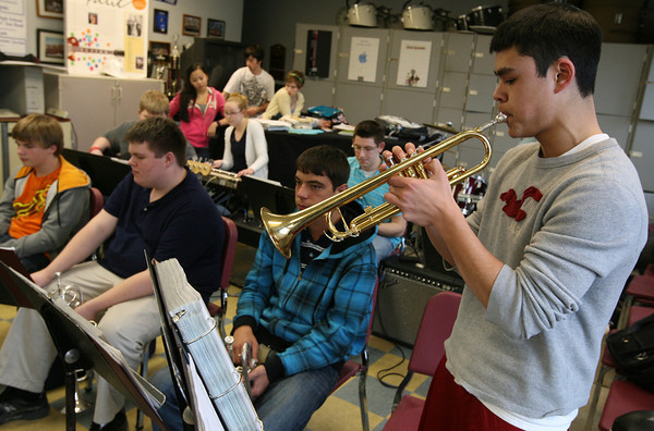 "Gloucester: Matt Catarino, student director of the Docksiders, plays the opening solo to ""Boogie Woogie Bugle Boy"" as they rehearse for their upcoming conert, which will feature the band's alumni from the past decade. Photo by Kate Glass/Gloucester Daily Times"