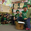 Rockport: George Ramsden pulls a gold coin from behind Abby Marshall's ear as his grandson, Adam Ramsden, and Abby's kindergarten classmates watch yesterday. Ramsden has been going into kindergarten classrooms for the past 19 years telling leprechaun stories on St. Patrick's Day. Photo by Kate Glass/Gloucester Daily Times