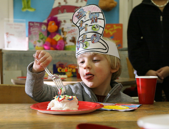 Essex: Jack Bediz sticks out his tongue as he digs in to a piece of birthday cake at the TOHP Burnham Library while celebrating the birthday of Dr. Seuss on Thursday. Photo by Kate Glass/Gloucester Daily Times