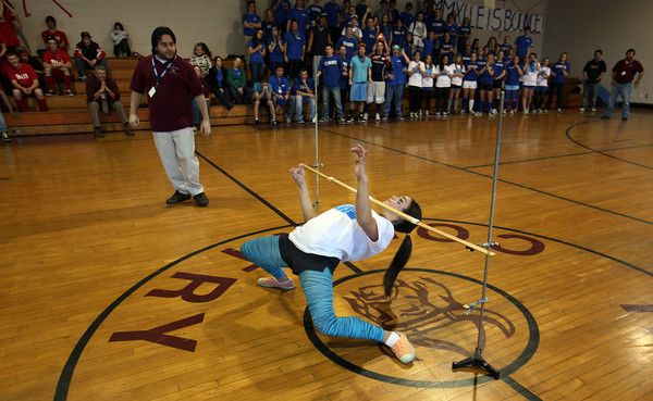 AMY SWEENEY/Gloucester Daily Times. Julia Sanfilippo, a senior at Rockport High School, wins the limbo contest for her class with a stunningly low bar of 25 inches during the Rockport Spirit Week Final Assembly