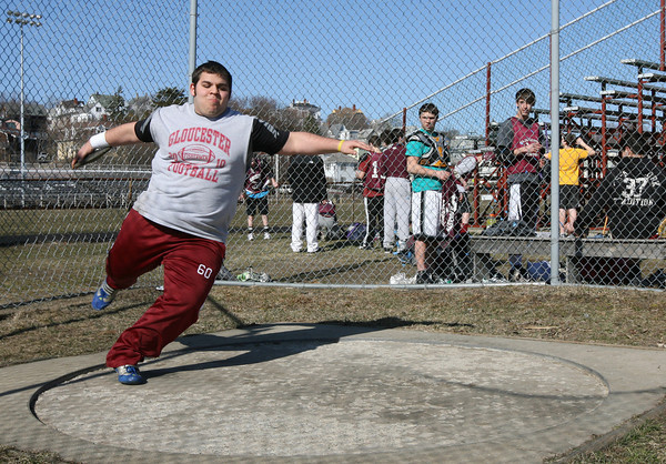 Gloucester: Andrew Porper practices throwing the discus during track practice yesterday. Photo by Kate Glass/Gloucester Daily Times