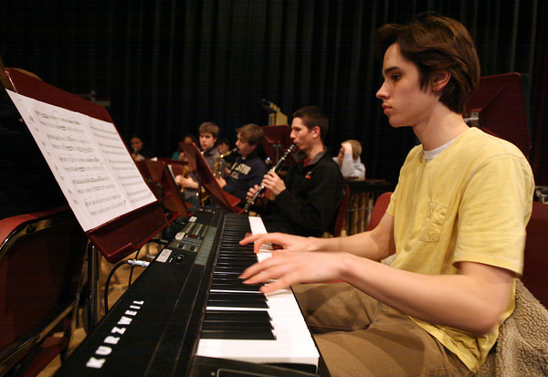Rockport: Robin Lovell plays the keyboard as the Rockport High School band rehearses for their spring concert yesterday. The high school concert was last night and the middle school band will perform tonight at 7:30. Photo by Kate Glass/Gloucester Daily Times