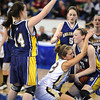 owell: Gloucester's Hannah Cain fights for the ball against Arlington Catholic in the division 2 North Finals at the Tsongas Arena Saturday night in Lowell. Desi Smith/Gloucester Daily Times.