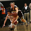 Gloucester point guard Hannah Cain steals the ball away from Reading's Katherine Callahan during the MIAA Division 2 North Semi-Finals at Woburn High School last night. Photo by Kate Glass/Gloucester Daily Times