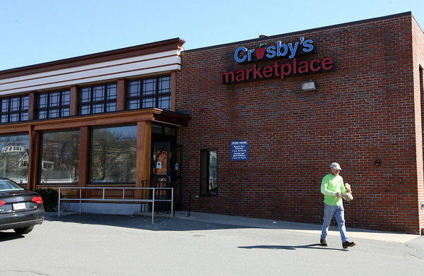 Manchester: Rob Lations of Manchester heads out of Crosby's Marketplace after doing some shopping yesterday. Many Rockport residents are hopeful that Crosby's will move into the location of the former IGA, which closed in January. Photo by Kate Glass/Gloucester Daily Times
