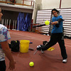 Gloucester: Alexis Palazzolo keeps her eye on the ball as she and Joelle Brooks try out for the Gloucester softball team in the Benjamin A. Smith Fieldhouse yesterday. Yesterday was the first day of the high school spring sports season. Photo by Kate Glass/Gloucester Daily Times