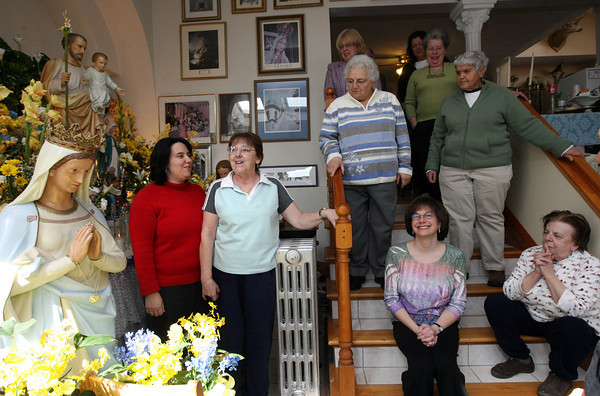 Gloucester: Frances Ferrante leads a song from the St. Joseph's novena while standing with her daughter, Rep. Ann-Margaret Ferrante, and guests yesterday afternoon. Frances' mother held the Feast of Saint Joseph for 49 years and she has been continuing the tradition for the past 14 years. Photo by Kate Glass/Gloucester Daily Times