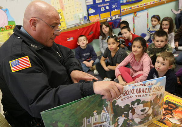 Gloucester: Gloucester Police Officer Scott Duffany reads to first grade students at Veterans Memorial Elementary School yesterday as part of Read Across America. Photo by Kate Glass/Gloucester Daily Times