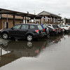 Rockport: The parking lot for the Rockport commuter rail station has been turned into a pond several times this week due to heavy rains and poor drainage. The MBTA had planned to renovate the station, but downscaled the original plans due to issues with funding. Photo by Kate Glass/Gloucester Daily Times