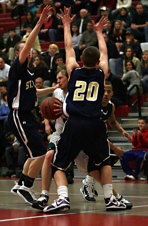 Salem: Manchester guard Sean Nally is double-teamed by St. Mary's Devin Thompson and Matt Manning during the MIAA Division 4 North Semi-Finals at Salem High School last night. Photo by Kate Glass/Gloucester Daily Times
