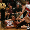 Gloucester center Sophia Black dives for a loose ball as Reading's Melissa Dalpozzo and Katherine Callahan try to grab it during the MIAA Division 2 North Semi-Finals at Woburn High School last night. Photo by Kate Glass/Gloucester Daily Times