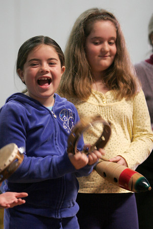 "Gloucester: Kevyn Chandler, left, and Lara Brighi smile as they get to perform with the chamber group, ""Music at Eden's Edge"" at East Gloucester Elementary School on Wednesday. Photo by Kate Glass/Gloucester Daily Times"