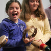 """Gloucester: Kevyn Chandler, left, and Lara Brighi smile as they get to perform with the chamber group, """"Music at Eden's Edge"""" at East Gloucester Elementary School on Wednesday. Photo by Kate Glass/Gloucester Daily Times"""