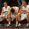 Salem: Marc Shields, Alex Porter, and Joe Mussachia hang their heads following their 75-64 loss to St. Mary's of Lynn during the MIAA Division 4 North Semi-Finals at Salem High School last night. Photo by Kate Glass/Gloucester Daily Times