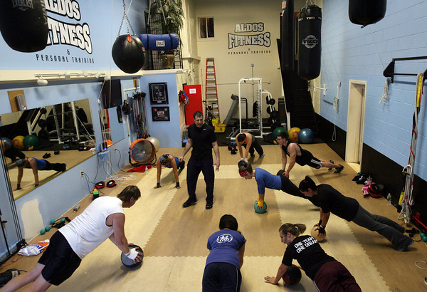 "Gloucester: Aldo Telliccia of Aldo's Fitness leads a cardio kickboxing class yesterday evening. Aldo's also offers spinning, Bosu classes, bender ball workouts and a ""Flirty Girl"" class. Photo by Kate Glass/Gloucester Daily Times"