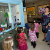 Gloucester: West Parish Elementary School Principal Jean Perry holds the hands of prospective kindergarten students Antonjeta Vila, left, and Jordan Palk, right, while giving a tour of the school during an open house yesterday morning. Today is open enrollment for kindergarten and first grade students, which takes place at the Fuller School from 8:30-1:30 and 4:30-6:30. Photo by Kate Glass/Gloucester Daily Times