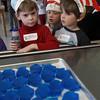Manchester: Jackson Ring, Lucy Lopardo, and Henry Otterbein try to figure out what lunch is at Manchester Memorial Elementary School on Wednesday as the school celebrates the birthday of author Dr. Seuss. Lunch included green eggs and ham as well as red fish and blue fish. Photo by Kate Glass/Gloucester Daily Times