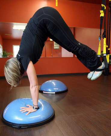 Rockport: Nicole Gomez recently opened Studio G in Rockport, which offers small classes focusing on core strength as well as personal training. Here she demonstrates a pike on bosu. Photo by Kate Glass/Gloucester Daily Times