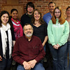 Gloucester: Dr. Richard Sagall, President of NeedyMeds, is surrounded by members of his staff at their Gloucester office on Maplewood Avenue. The staff members are: Elizabeth Messenger, Damaris Mercedes, Sam Rulon-Miller, Robin Hoffman, Bill Kyrouz, Abby Marsh, and Jaye Van Dussen. Photo by Kate Glass/Gloucester Daily Times
