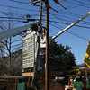 Gloucester: National Grid employees build a bracket around a telephone pole that cracked yesterday. The crew had to shut off power temporarily while stabilizing the pole. Photo by Kate Glass/Gloucester Daily Times