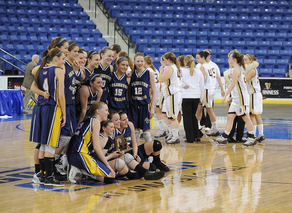 Lowell: Gloucester girls leave the floor after loosing in the division 2 North Finals to Arlington Catholic at the Tsongas Arena Saturday night in Lowell. Desi Smith/Gloucester Daily Times.