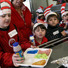 Manchester: Luke Needham, a kindergarten student at Manchester Memorial Elementary School, looks at his lunch of green eggs and ham and a jello blue fish as the school celebrates the birthday of Dr. Seuss yesterday. Photo by Kate Glass/Gloucester Daily Times