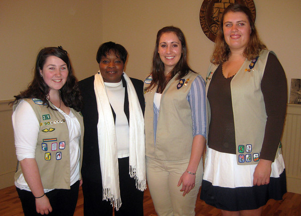 Rockport: Molly Sonia, Sabrina McCarthy, and Emily Collins stand with Violet Apple, Chief Membership Services Officer of Girl Scouts of Eastern Massachusetts, after receiving their Gold Star award during a ceremony on Sunday. Courtesy Photo