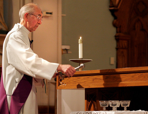 Gloucester: Deacon Dan Dunn blesses palm ashes with holy water during an Ash Wednesday service at St. Ann Church yesterday afternoon. Ash Wednesday is the first day of Lent, the season leading up to Easter. Photo by Kate Glass/Gloucester Daily Times