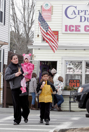 Manchester: Amanda Edmonds guides Hazelle Steriti and Thomas Steriti to Masconomo Park after getting ice cream cones at Captain Dusty's yesterday afternoon. The store opened for the season yesterday. Photo by Kate Glass/Gloucester Daily Times
