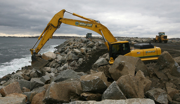 Rockport: A crew from Miller Golf Construction begins to repair the riprap at Granite Pier yesterday. The pier is closed to vehicle traffic while the repairs are being made. Photo by Kate Glass/Gloucester Daily Times