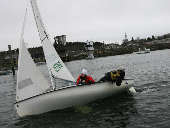 Manchester: Manchester Essex sailors Emily Arntsen and Captain Nate Jermain work on their technique as they prepare for their race against B.C. High yesterday afternoon. Photo by Kate Glass/Gloucester Daily Times