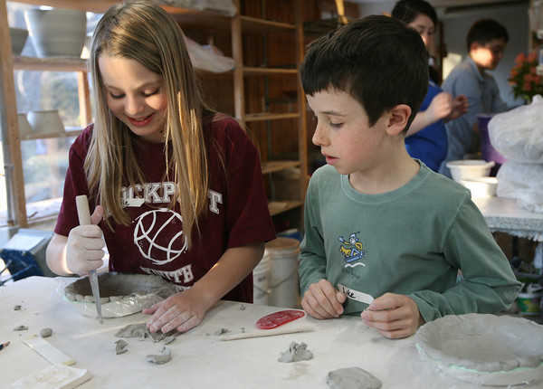 Rockport: Sofie Moulton and Luke Simpson work on bowls at Cynthia Curtis Pottery that they will donate to the Empty Bowl Dinner, a fundraiser for The Open Door. The Empty Bowl Dinner will be held on May 12th at Cruiseport in Gloucester. Photo by Kate Glass/Gloucester Daily Times