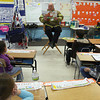 """Manchester: Gloucester Firefighter Frank LeClerc reads """"Oliver Tom and the Leprechaun"""" to first grade students at Veterans Memorial Elementary School as part of the Read Across America program yesterday. Mayor Carolyn Kirk, Fire Chief Phil Dench and GFAA President Jonathan Pope were also guest readers for the day. Photo by Kate Glass/Gloucester Daily Times"""