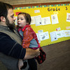 Gloucester: Jay Harrison carries his daughter, Aurelia, through the halls at West Parish Elementary School as they go on a tour of the school yesterday morning. Aurelia will be in kindergarten at the school next year. Photo by Kate Glass/Gloucester Daily Times